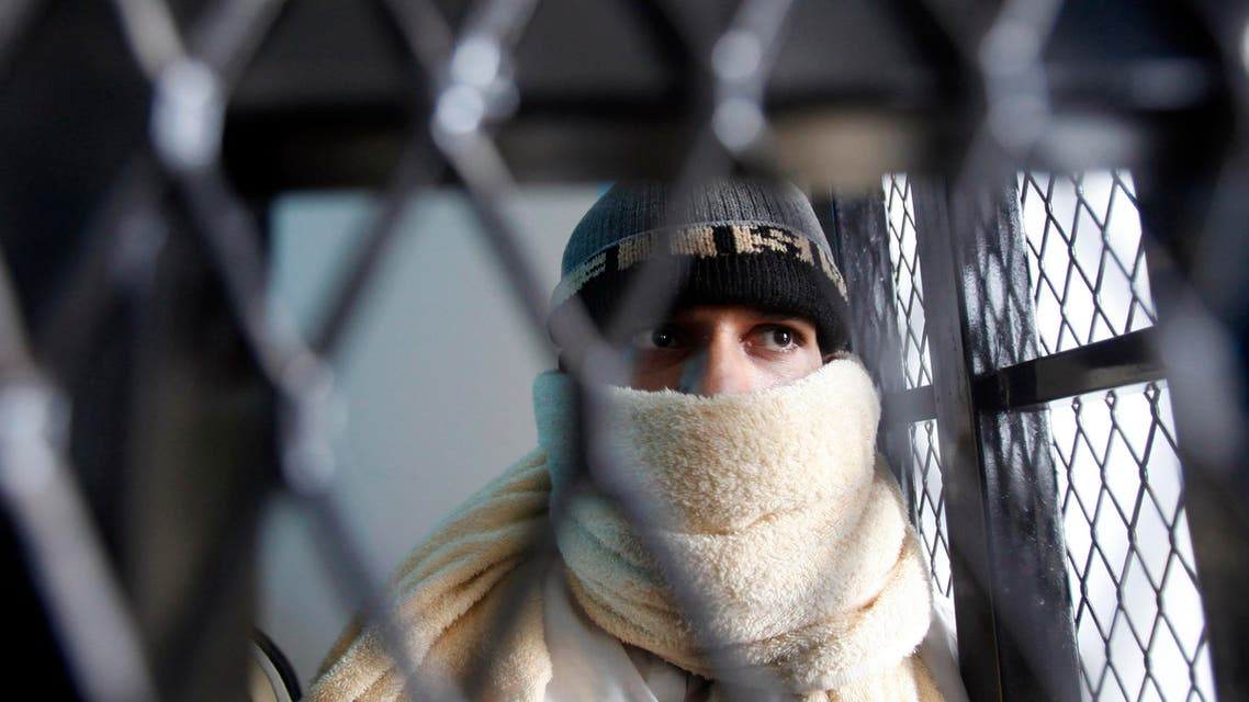 A suspected al Qaeda militant appears behind bars at the state security court of appeals in Sanaa March 26, 2013.