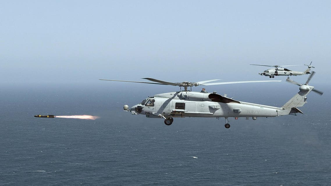 An MH-60R Seahawk firing a Hellfire missile during training near San Diego, California. The United States will speed up delivery of missiles and surveillance drones to Iraq. (AFP)