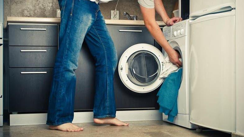 Australia police free naked man stuck in washing machine