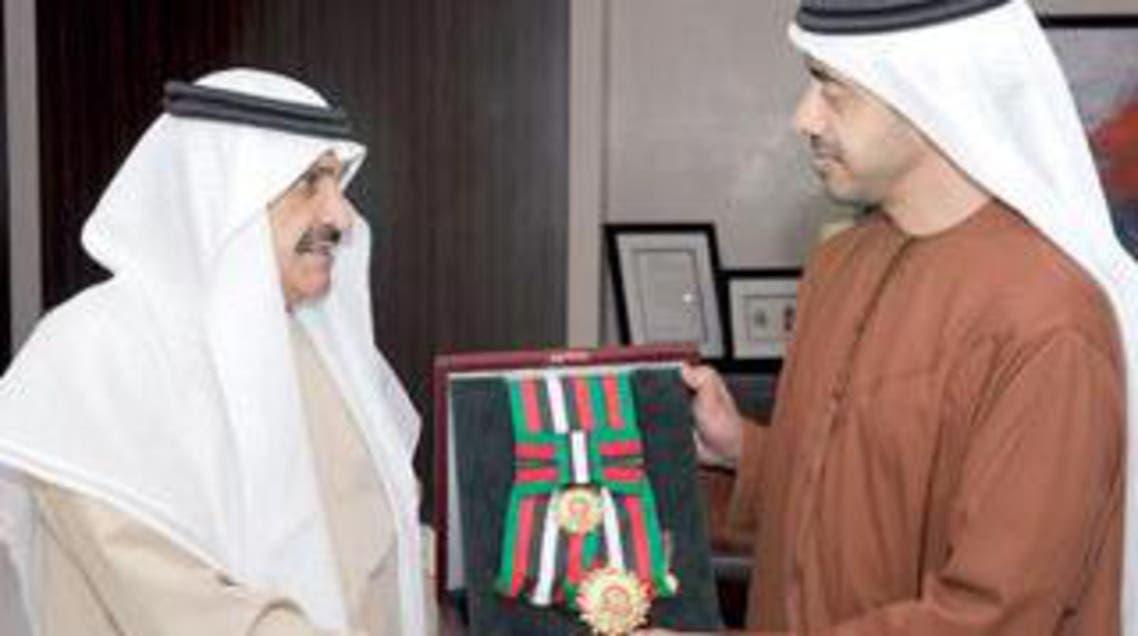وزير الخارجية الشيخ عبدالله بن زايد يقلد السفير السعودي وسام زايد