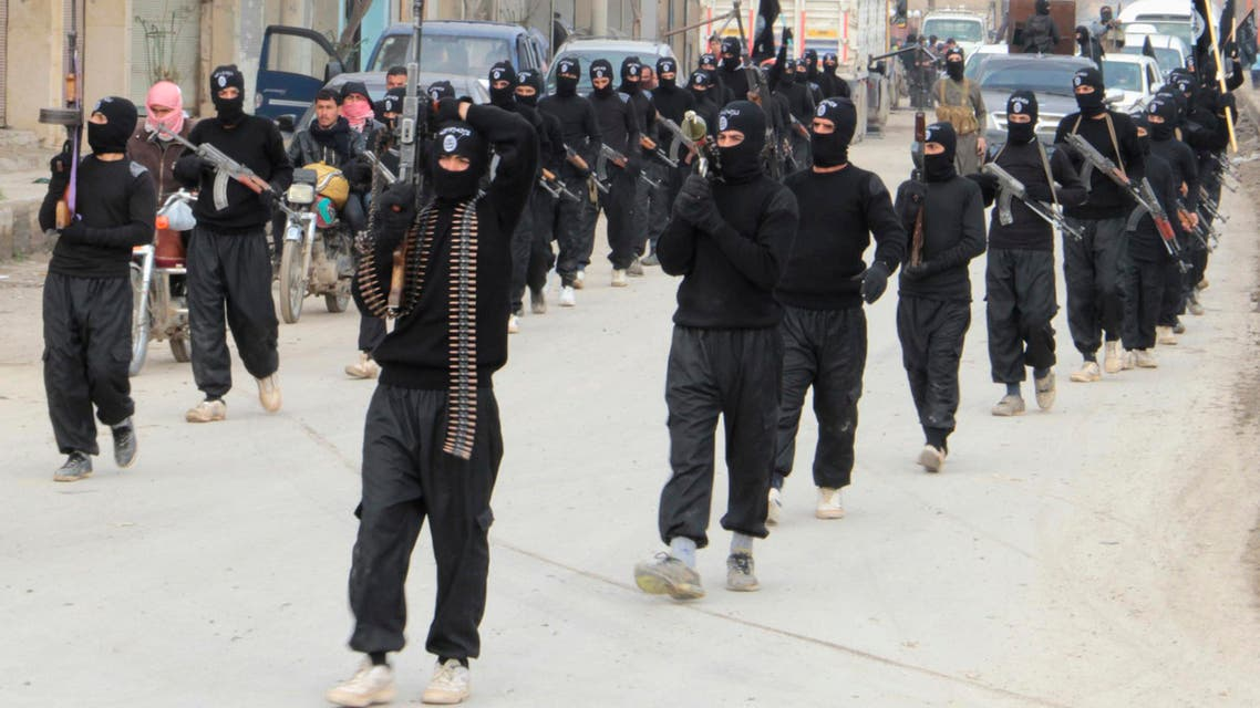 Fighters of al-Qaeda linked Islamic State of Iraq and the Levant carry their weapons during a parade at the Syrian town of Tel Abyad, near the border with Turkey Jan. 2, 2014. (Reuters)