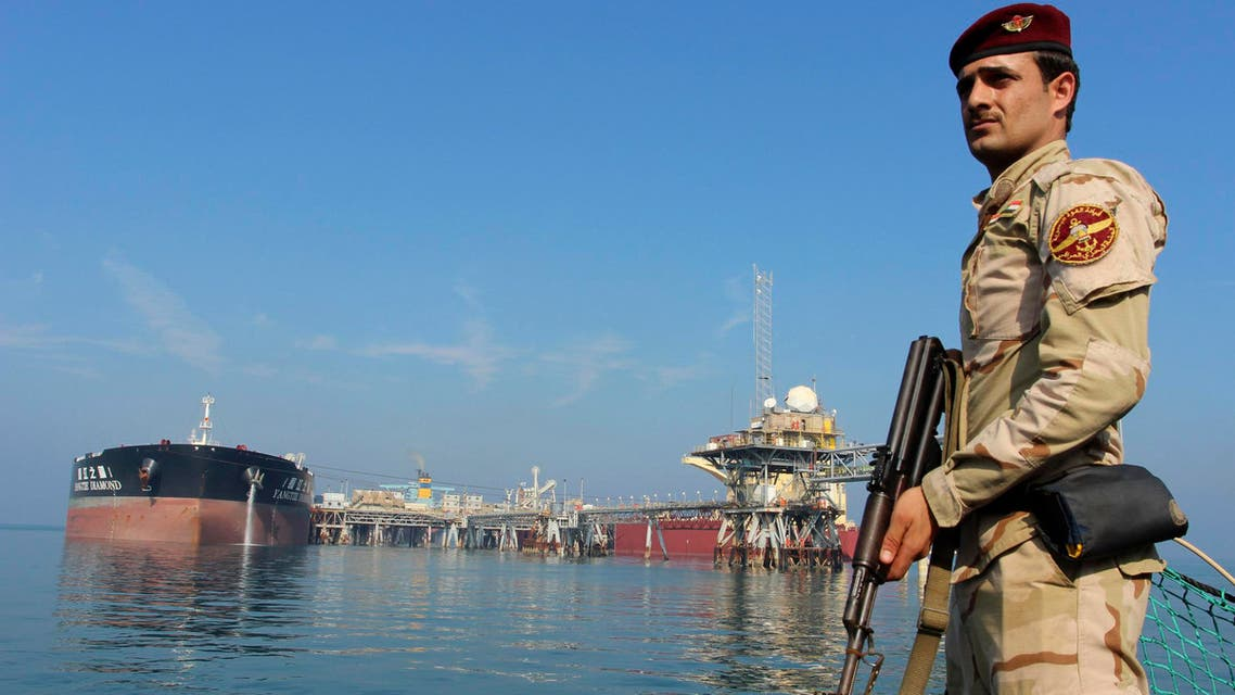 An Iraqi soldier stands guard near the Central Metering and Manifold platform (CMMP) at Al Basra oil terminal in the Middle East Gulf November 27, 2013. T