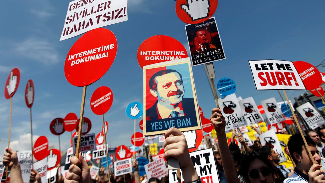 Demonstrators hold placards with some featuring a picture of Turkey's Prime Minister Tayyip Erdogan during a protest against internet censorship in Istanbul May 15, 2011. reuters