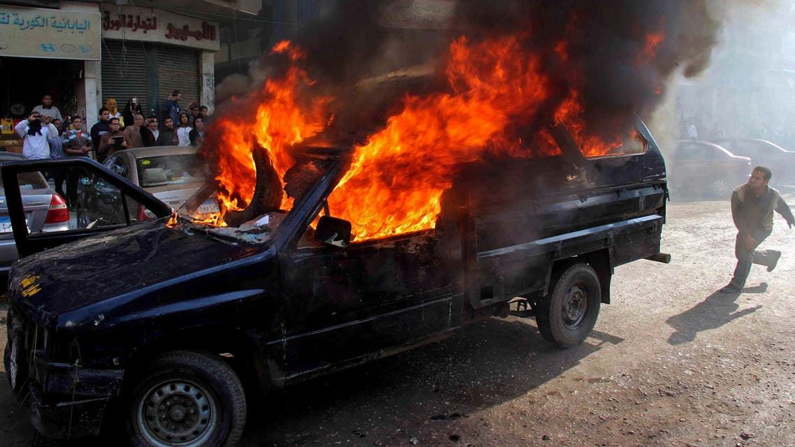 Protesters who support ousted President Mohammad Mursi, set a police vehicle on fire during clashes with riot police at Nasr City district in Cairo Jan. 10, 2014. (Reuters)