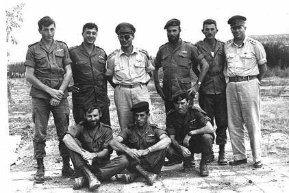 Sharon, top second from left, with members of Unit 101 after Operation Egged, Nov. 1955. (Photo courtesy: Wikimedia)