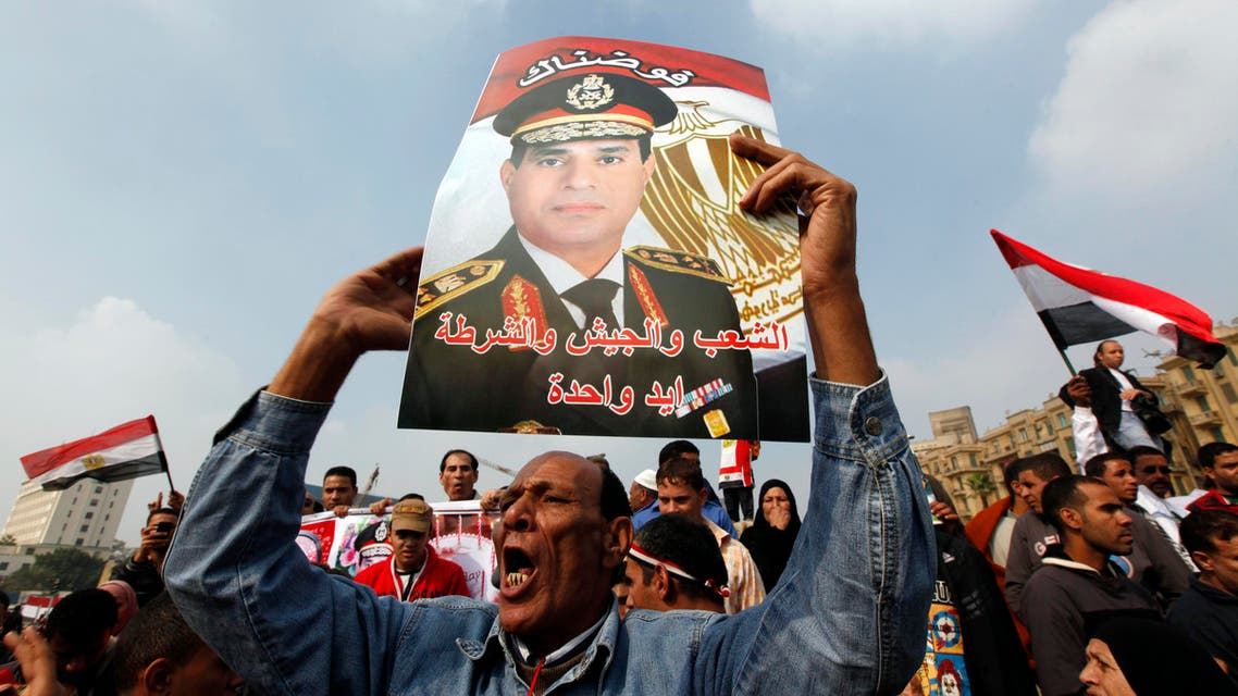 A supporter of Egypt's army chief General Abdel Fattah al-Sisi holds up a poster of Sisi at Tahrir square in downtown Cairo, Nov. 19, 2013. (Reuters)