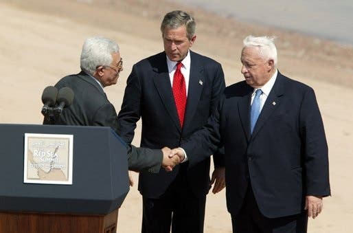 Palestinian President Mahmoud Abbas, United States President George W. Bush, and Ariel Sharon, Red Sea Summit, Aqaba, 2003. (Photo courtesy: Wikimedia)