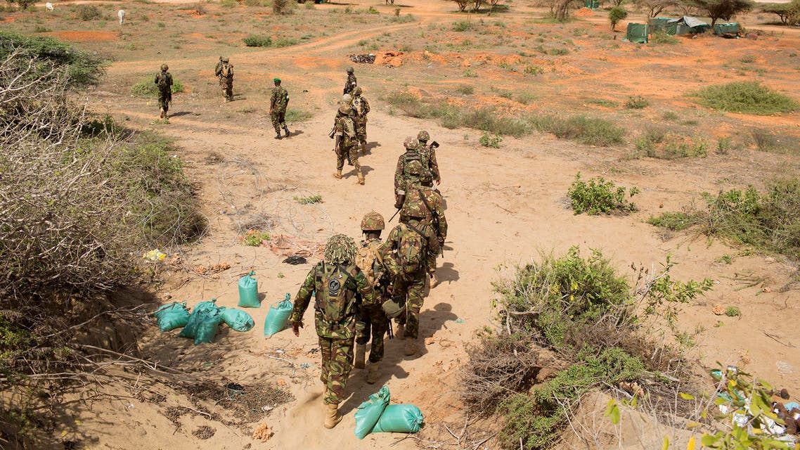 Kenya Defence Forces (KDF) soldiers, who are part of the African Mission in Somalia (AMISOM), march to their armoured vehicles before an area patrol on the outskirts of the controlled area of the old airport in the coastal town of Kismayu in southern Somalia Nov. 12, 2013. (Reuters)