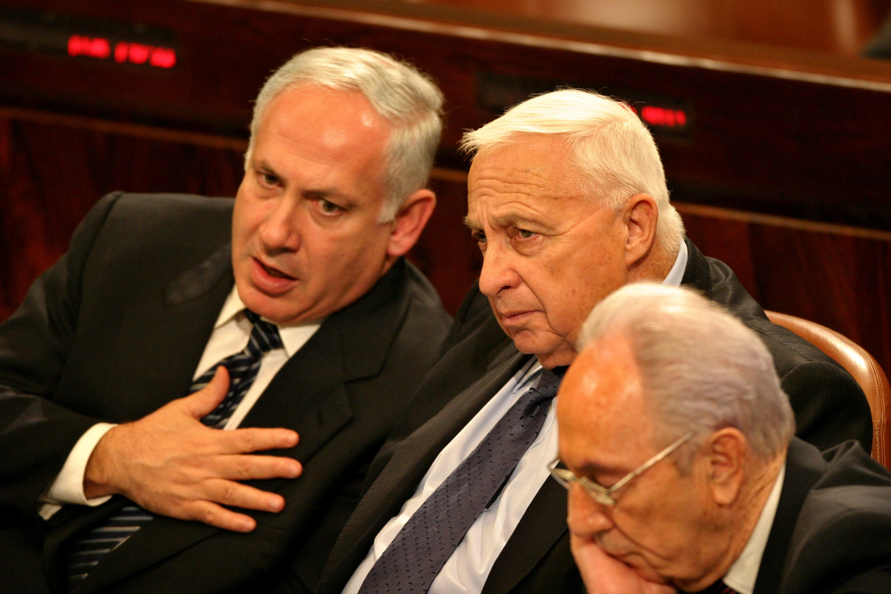 Israeli financial Minister Netanyahu, Prime Minister Sharon and Vice Premier Peres attend a session at the Israeli Parliament in Jerusalem. (L-R) Israeli financial Minister and former Prime Minister Benjamin Netanyahu, Israeli Prime Minister Ariel Sharon and his Vice Premier Shimon Peres attend a session at the Israeli Parliament in Jerusalem, February 14, 2005