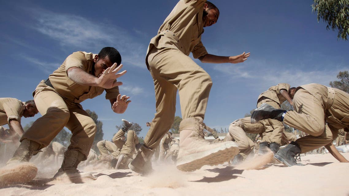 Newly recruited members of the Yemeni military police force participate in exercises at their barracks in Sanaa January 8, 2014