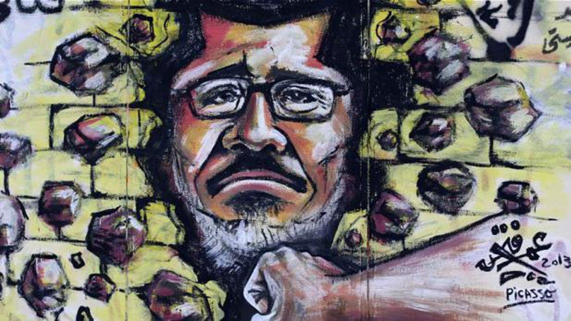 Graffiti depicting Egypt's Islamist President Mohammed Morsi covers an outer wall of the presidential palace in Cairo AP