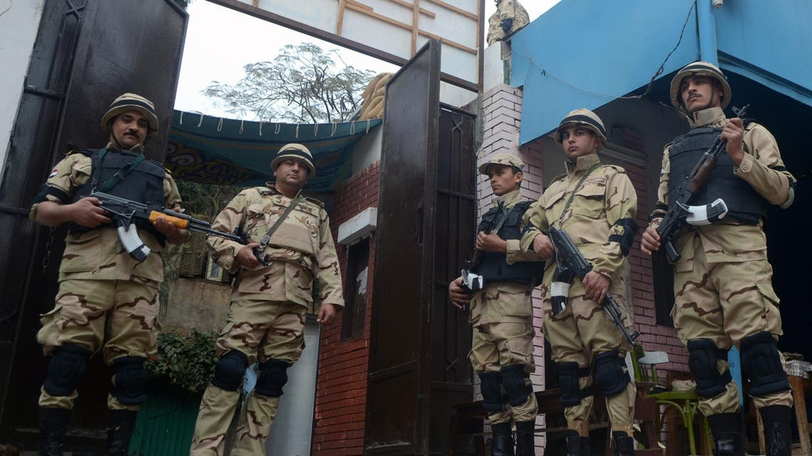 Egyptian soldiers stand guard in the courtyard of a school that will be used as a polling station on Jan. 13, 2014 in Cairo, as security forces are deployed two days ahead of a referendum on a new constitution. (Reuters)