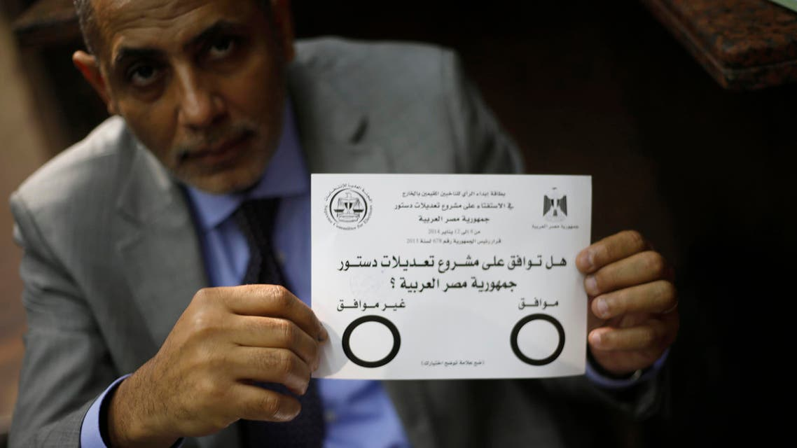 An Egyptian man displays the voting paper of a referendum on the new constitution at the Egypt Consulate in Dubai January 8, 2014.