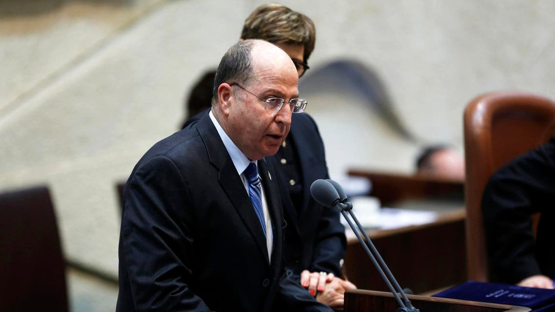 Israel's Defence Minister Moshe Yaalon speaks during a swearing-in ceremony, at the Knesset, Israeli Parliament, in Jerusalem March 18, 2013. (Reuters)