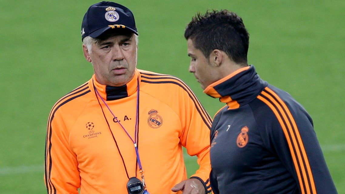 Real Madrid's coach Carlo Ancelotti (L) talks to player Cristiano Ronaldo during a training session at Juventus stadium in Turin Nov. 4, 2013.  (Reuters)