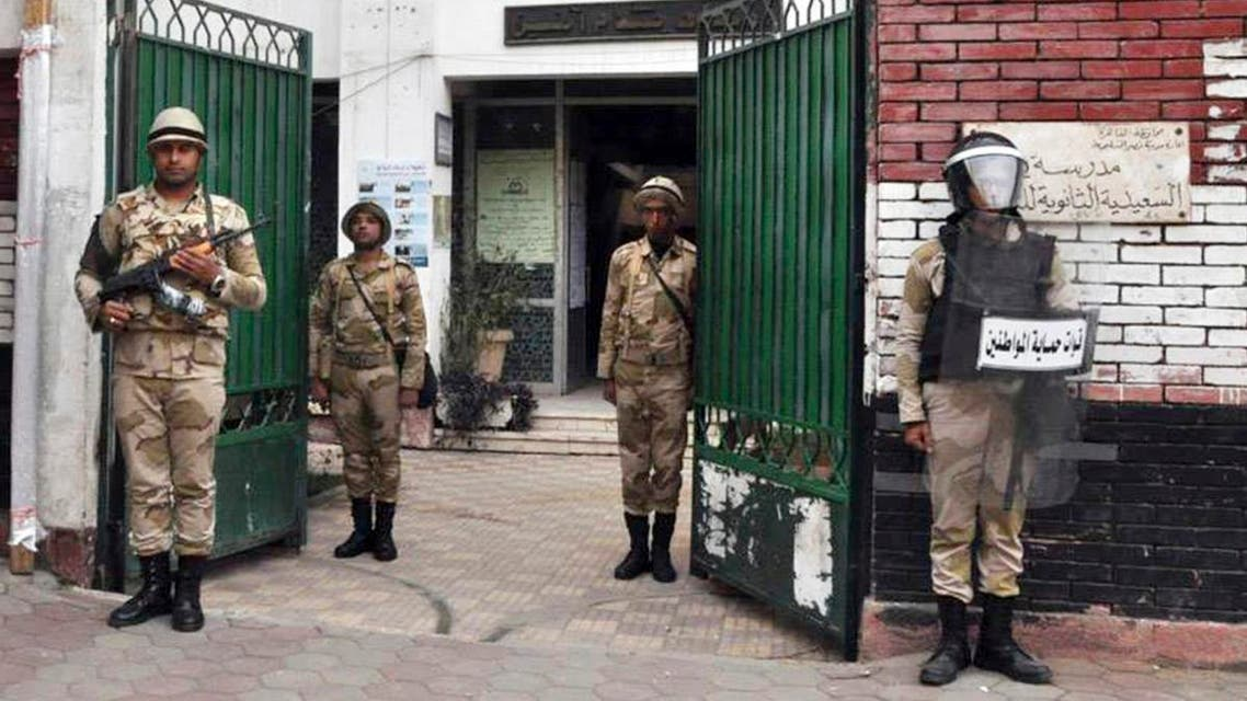 Egyptian soldiers stand guard in the courtyard of a school that will be used as a polling station in downtown Cairo January 13, 2014.