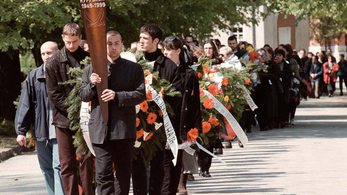 A funeral procession leads the coffin April 14 of prominent Serbian opposition journalist Slavko Curuvija, owner of the daily Dnevni Telegraf, who was killed in Belgrade April 11.