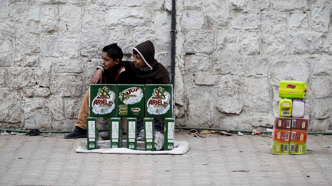 Children sell washing detergent in Aleppo on Dec. 1, 2013. The escalation of the civil war in Syria has taken its toll on the region's economy, the World Bank said. (File photo: Reuters)
