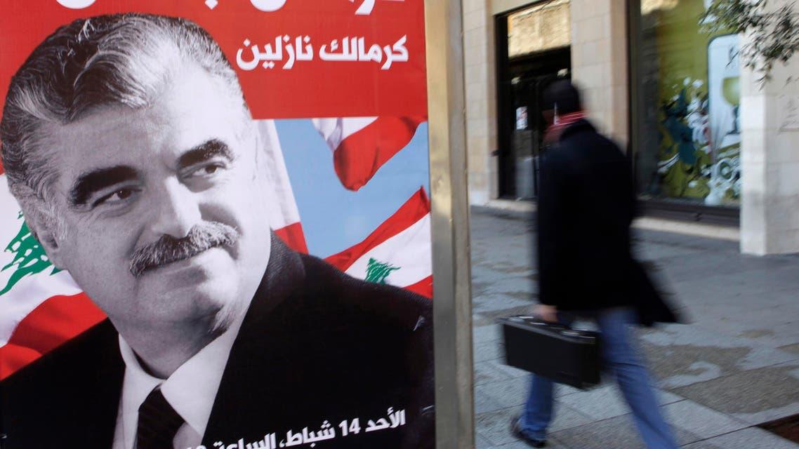 A man walks past a poster depicting Lebanon's assassinated former prime minister Rafik al-Hariri, in downtown Beirut February 10, 2010. reuters