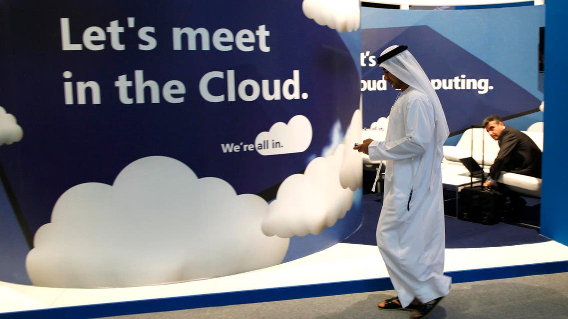 A visitor uses his mobile phone as he walks at the Gulf Information and Technology Exhibition (GITEX) in Dubai October 17, 2010. (Reuters)