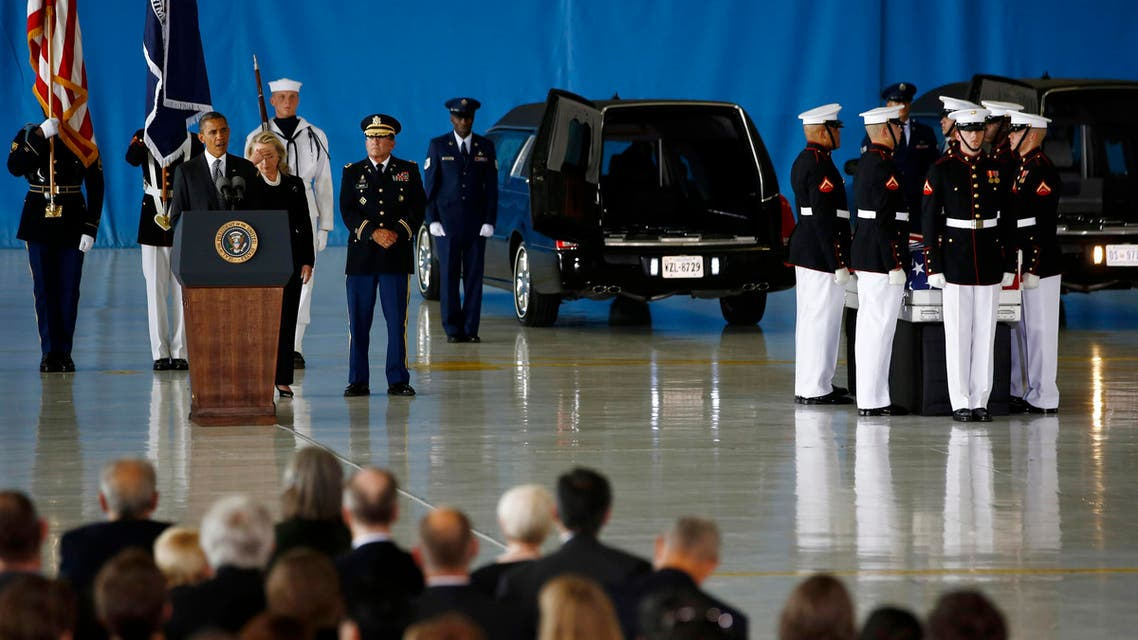 U.S. President Barack Obama and Secretary of State Hillary Clinton participate in a transfer ceremony of the remains of U.S. Ambassador to Libya, Chris Stevens and three other Americans killed this week in Benghazi, at Andrews Air Force Base near Washington,