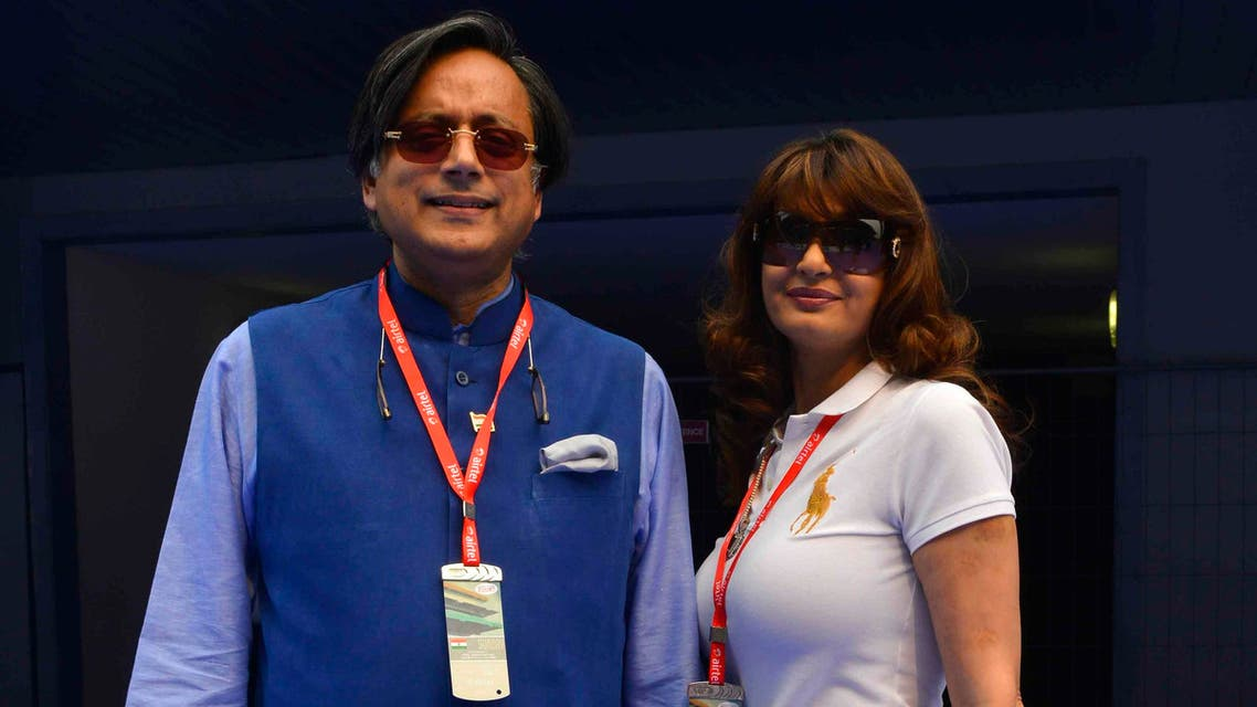 Sunanda Puskhar Tharoor (R), wife of India's Minister of State for Human Resource Development Shashi Tharoor, poses with her husband at the Indian F1 Grand Prix at the Buddh International Circuit in Greater Noida, on the outskirts of New Delhi, Oct. 27, 2013. (Reuters)