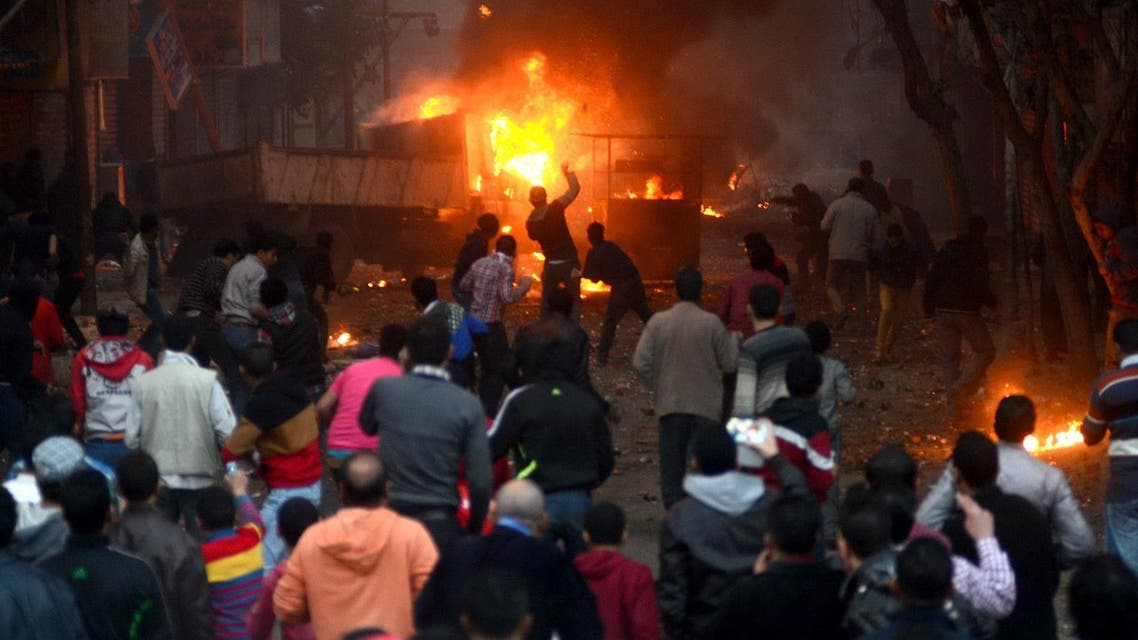 Supporters of the Muslim Brotherhood clash with civilians and Egyptian riot police in Alf Masskan district in the capital Cairo on Jan. 17, 2014. (Reuters)