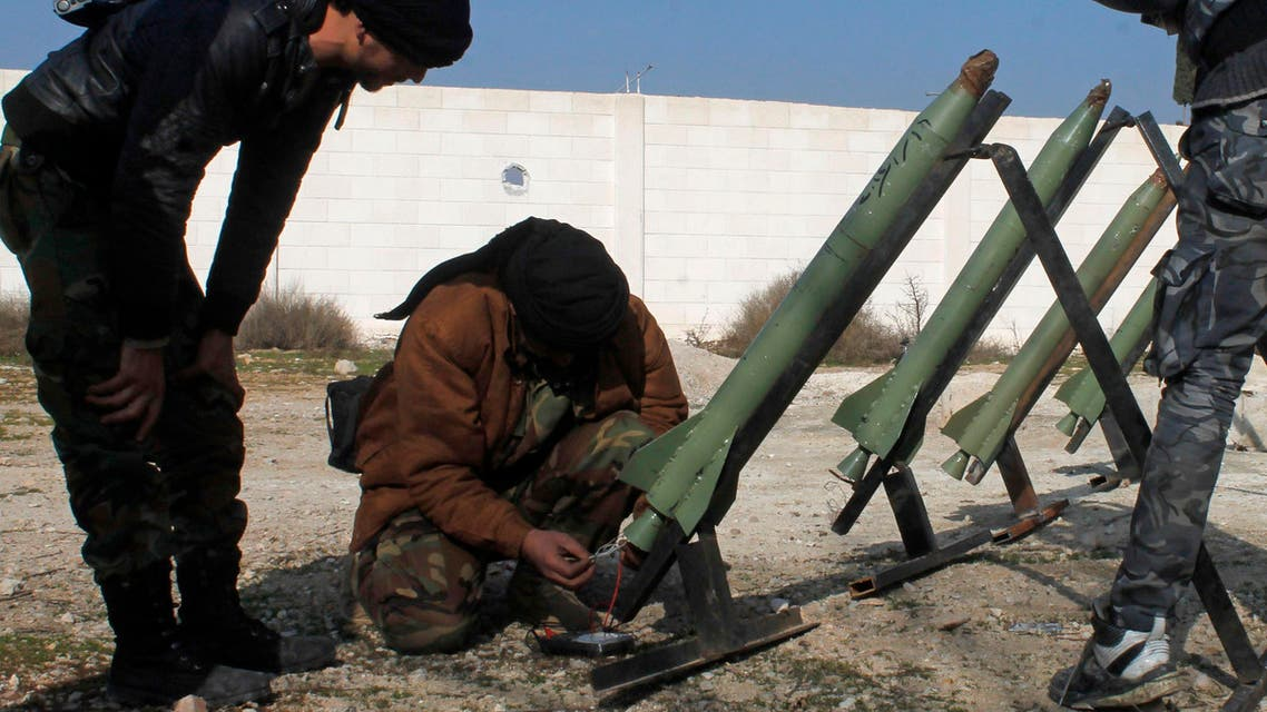 Fighters from the Free Syrian Army's Saif al-Umayyad brigade prepare rockets to be launched towards forces loyal to Syria's President Bashar al-Assad in the eastern Damascus suburb of Ghouta January 16, 2014. reuters