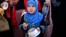 Palestinian official: aid enters besieged Damascus refugee camp