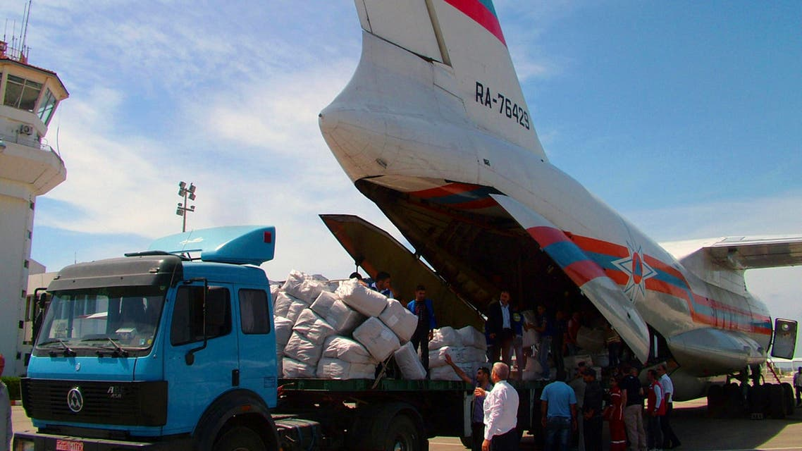 Workers are seen unloading humanitarian aid sent from Russia to the Syrian government in this handout photograph distributed by Syria's national news agency SANA on May 28,2013. Reuters