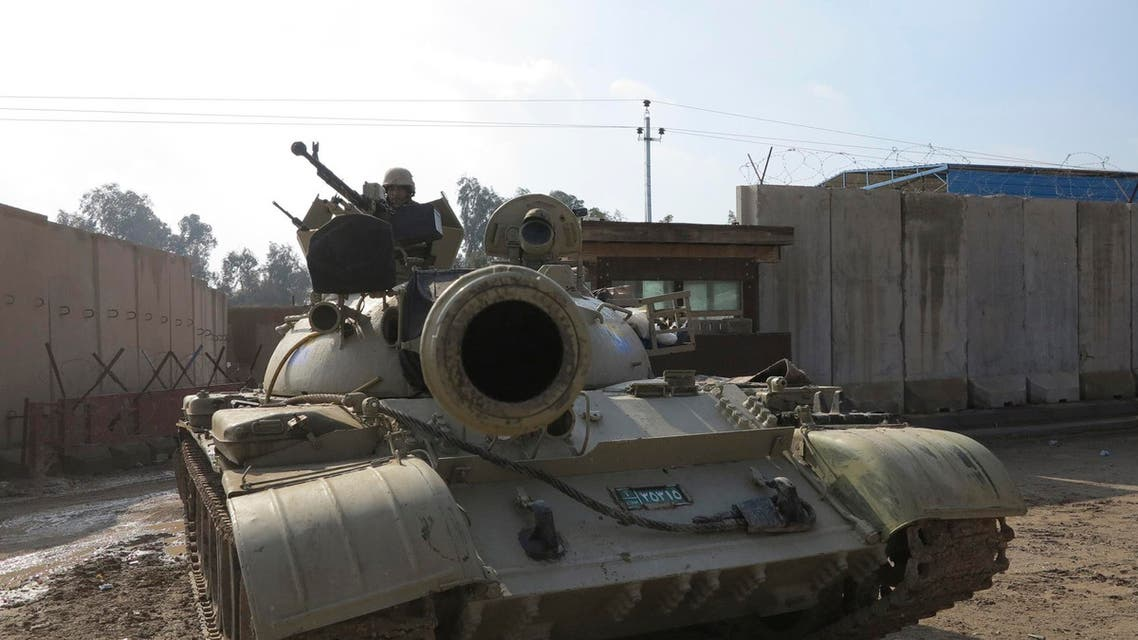 An Iraqi soldier sits in a tank during an intensive security deployment on the streets of Ramadi. (Reuters)
