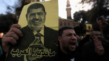 Islamist Mursi, secularists charged in new case