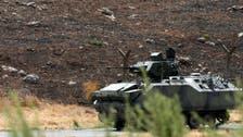 Turkey patrols Syria border, wary of weapon trade