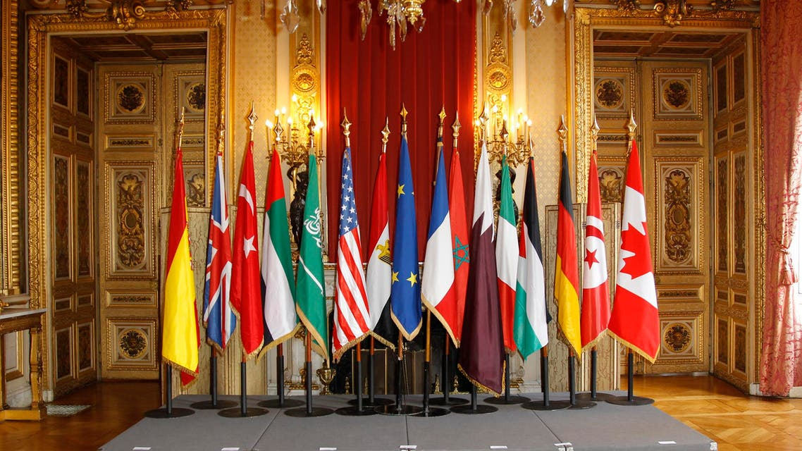 """Flags are seen prior to the family photo at the meeting, """"The Friends of Syria"""" in Paris April 19, 2012. (Reuters)"""