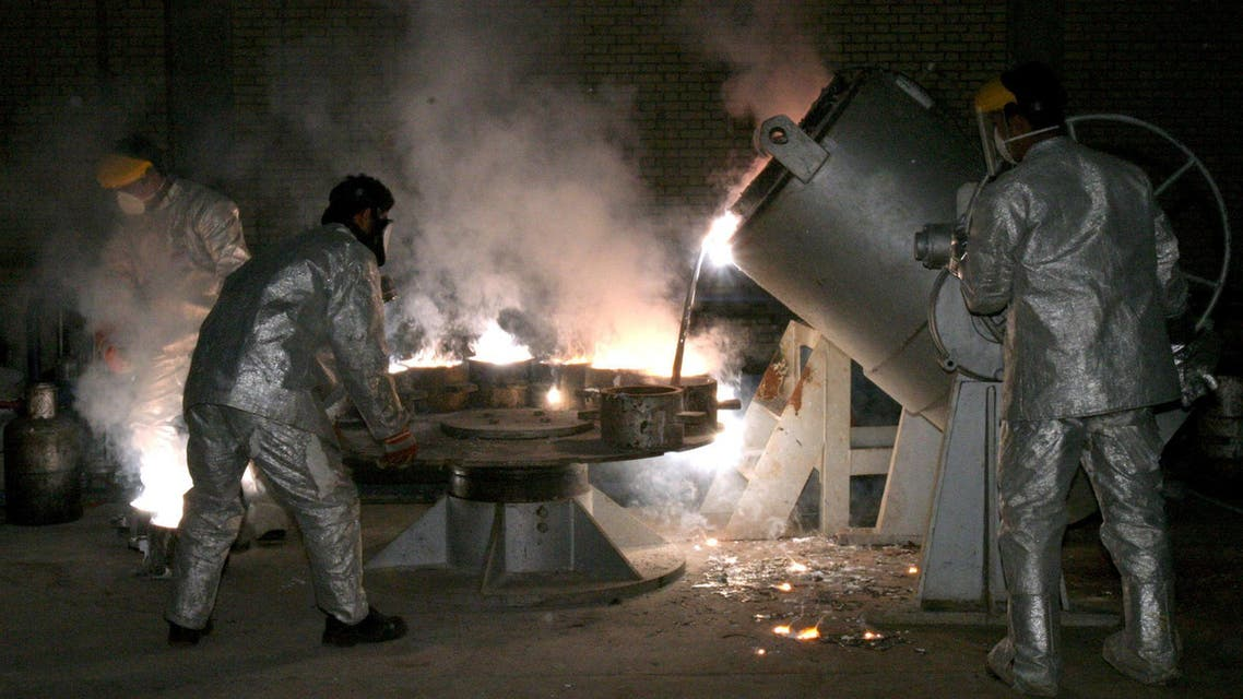 Technicians work at a uranium processing site in Isfahan 340 km (211 miles) south of the Iranian capital Tehran March 30, 2005. reuters