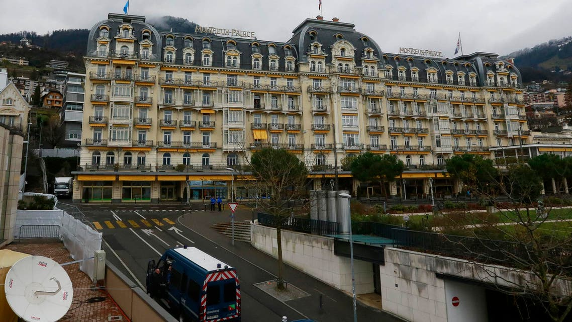 Swiss Police in their vehicles secure the area in front of the Montreux Palace hotel where the Geneva II conference will take place in Montreux Jan. 21, 2014.  (Reuters)