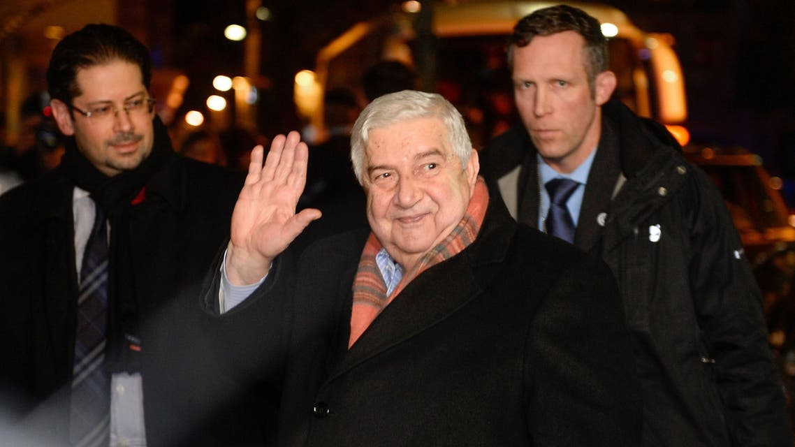 "Syrian Foreign Minister Walid Muallem (C) gestures upon his arrival on Jan. 21, 2014 on the eve of the so-called ""Geneva II"" peace talks in Montreux. (Reuters)"