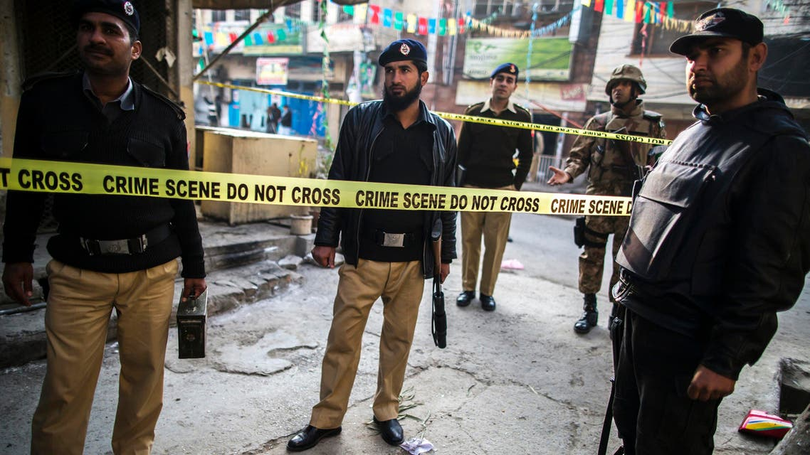Security officials cordon off the site of a suicide blast in Rawalpini January 20, 2014.