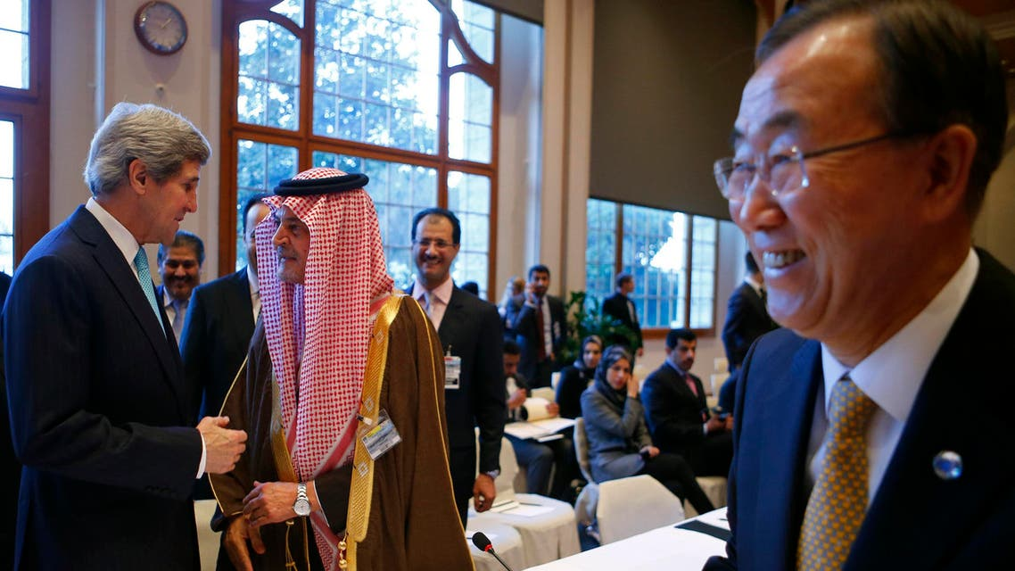U.S. Secretary of State John Kerry (L) talks to Saudi Arabia's Foreign Minister Prince Saud al-Faisal (2nd L) as U.N. Secretary-General Ban Ki-moon (R) walks past prior to the Geneva-2 peace talks in Montreux Jan. 22, 2014. (Reuters)