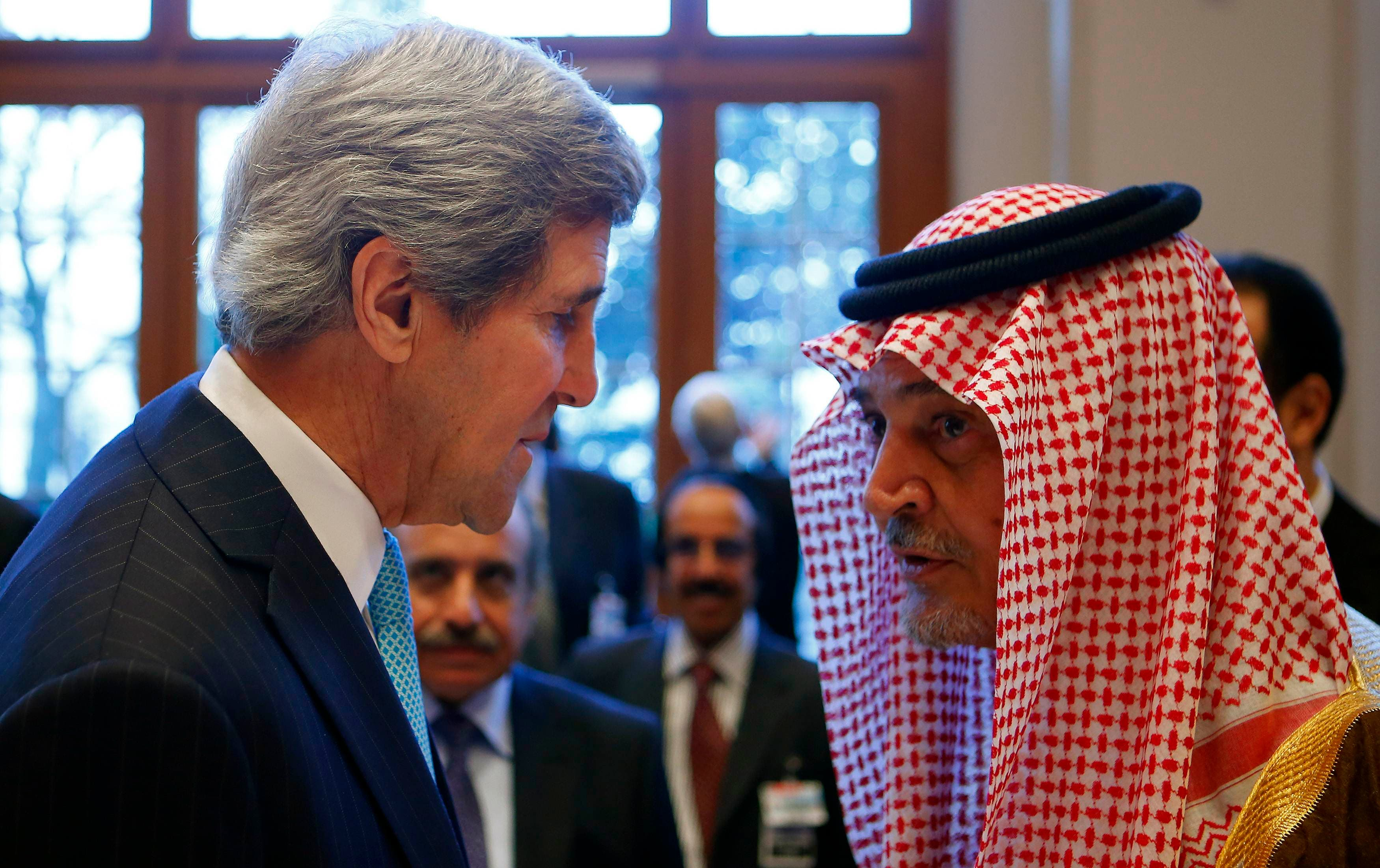 U.S. Secretary of State John Kerry (L) talks to Saudi Arabia's Foreign Minister Prince Saud al-Faisal prior to the Geneva-2 peace talks in Montreux Jan. 22, 2014. (Reuters)