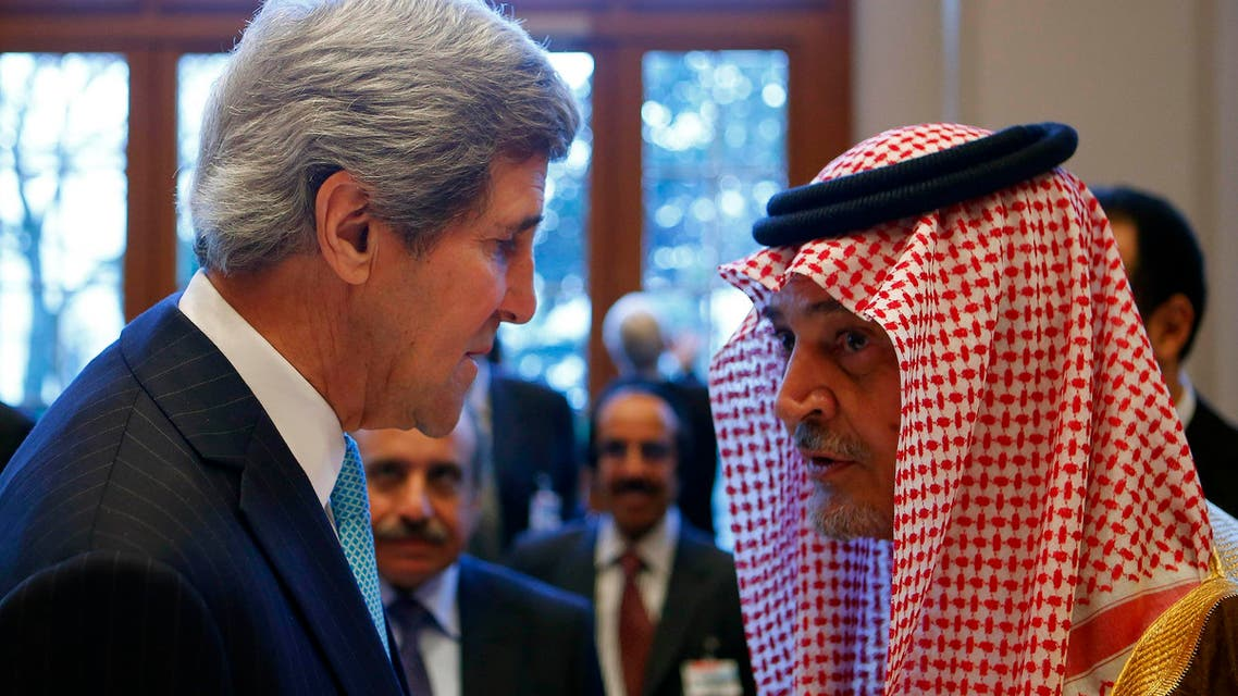U.S. Secretary of State John Kerry (L) talks to Saudi Arabia's Foreign Minister Prince Saud al-Faisal prior to the Geneva-2 peace talks in Montreux Jan. 22, 2014. (Reuters)