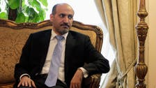 Syria TV shows opposition head alongside 'terrorist crimes'