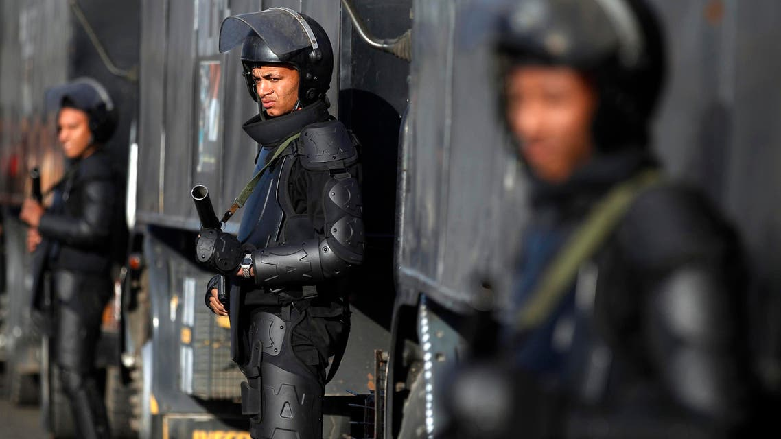 Riot police stand guard outside a police academy, where ousted Egyptian President Mohammad Mursi's second trial session was due to take place, on the outskirts of Cairo Jan.8, 2014. (Reuters)