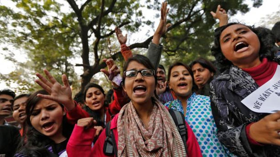 Demonstrators shout slogans and raise their hands during a protest for a gang rape victim in New Delhi January 16, 2013.