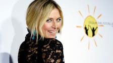 Video: Sharapova flirts with journalist during press conference