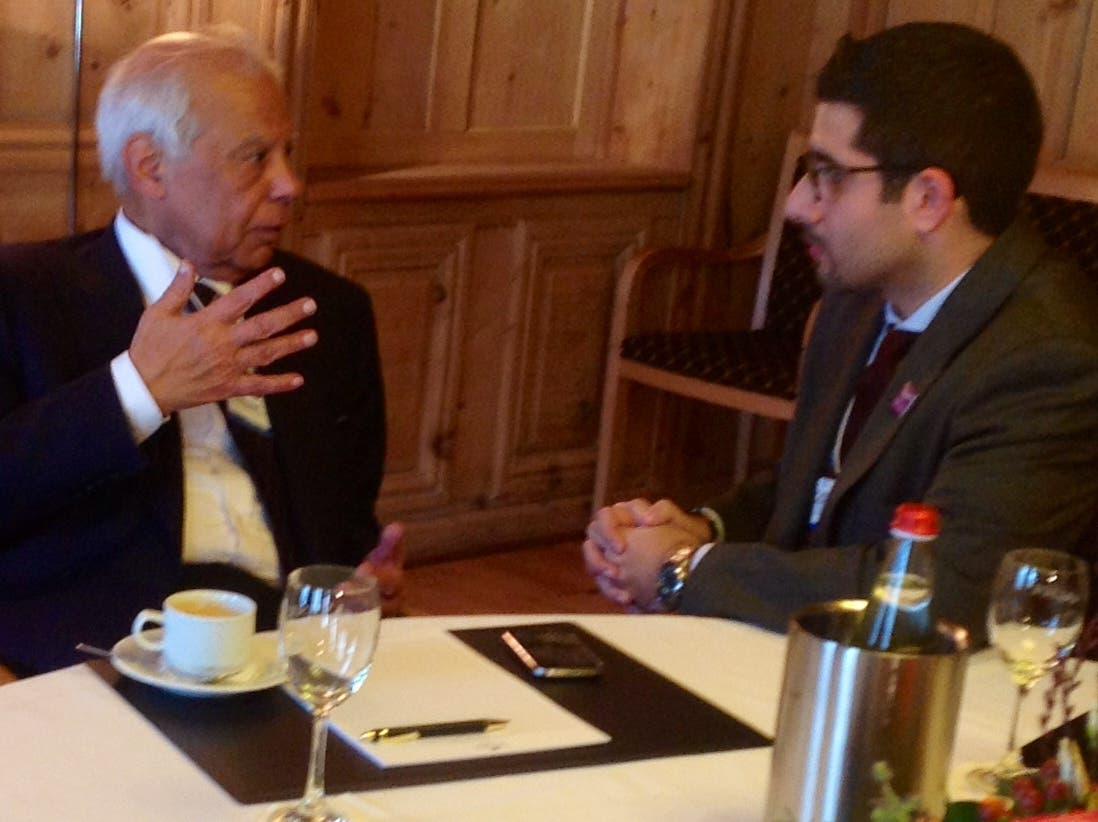 Egyptian PM Hazem el-Beblawi, left, speaks with Al Arabiya News Editor-in-Chief Faisal J. Abbas in Davos. (Al Arabiya)