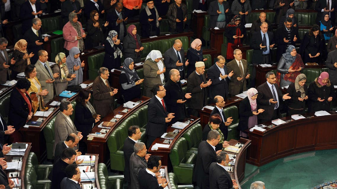 Tunisian MPs recite the Fatiha, the opening Surat (brief chapter) of the Koran, during a meeting at the National Constituent Assembly (NCA) as part of the debates on a new constitution on Jan. 23, 2014, in Tunis. (AFP)