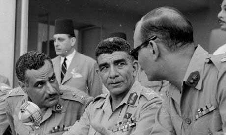 Mohammad Naguib (C) and Nasser (L) pictured here shortly after the Free Officers took power in 1952 (File photo: Reuters)