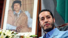 Qaddafi son ordered back to house in Niger