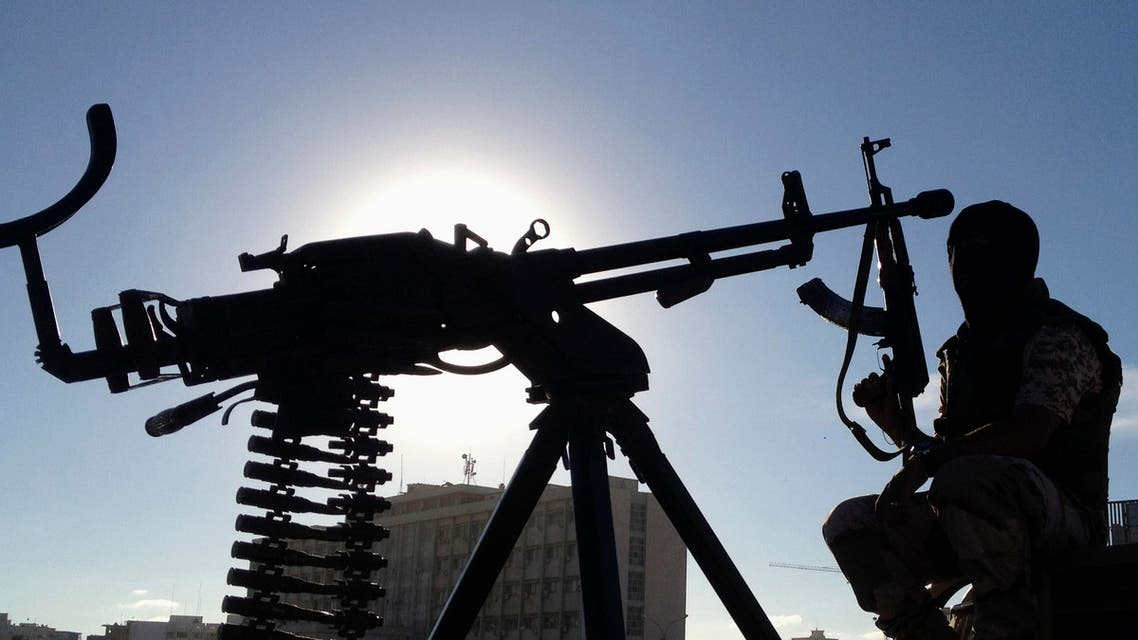 A member of the Libyan Army special forces who took military action against a militia group that took over public land, holds his weapon, in Benghazi October 3, 2013.